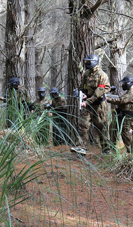 Players about to flank the other team, at Delta Force Paintball